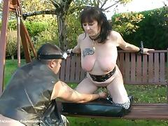 Still on the swing my master continues to slap my big breasts and  by pulling on my nipples  he..